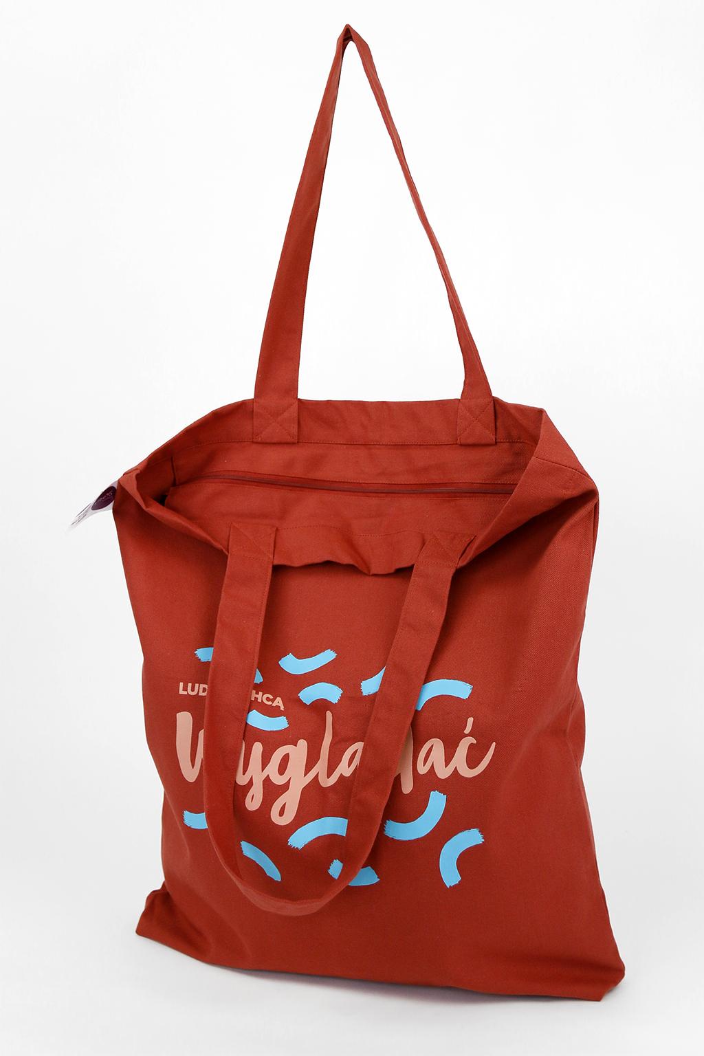 bawełniana torba na ramię zamykana na zamek błyskawiczny, torba w kolorze ceglanym z kolorowym nadrukiem: ludzie chcą wyglądać